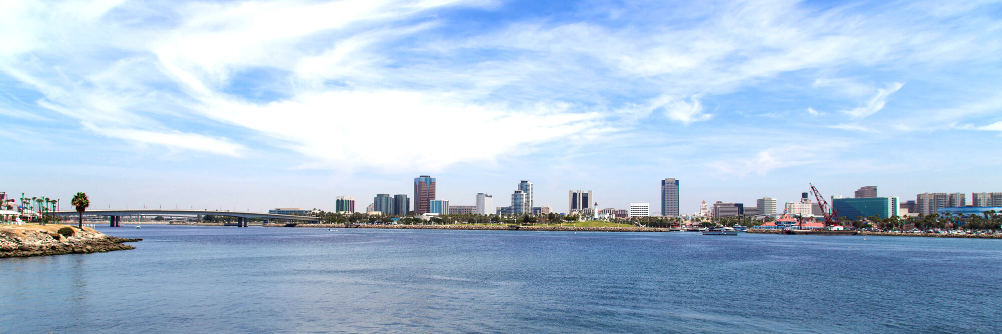 A wide panoramic view of Long Beach and a bridge
