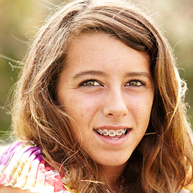 A young teenage girl with braces